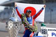 Indianapolis 500 champion Takuma Sato, of Japan, poses with the Borg-Warner Trophy. Photo / AP
