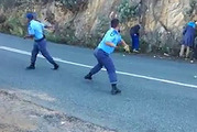 Sitting ducks: In footage of the punishment, the policemen giggle and egg each other on as they throw the apples as hard as they can, hitting the helpless men in the head, back and legs.