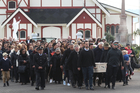 John Chadwick's body is carried onto the marae this morning. Photo/Stephen Parker