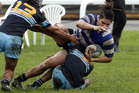 St Johns Whanganui Metro skipper George Forster is well held during his side's 53-17 demolition of Kia Toa on Saturday. PHOTO/Stuart Munro