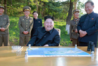 North Korean leader Kim Jong Un watches the test launch of a solid-fuel 'Pukguksong-2' at an undisclosed location. Photo / AP