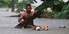 A Sri Lankan man rows a makeshift raft on a flooded road in Wehangalla village in Kalutara district. Photo / AP