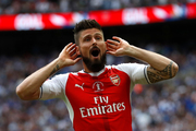 Arsenal's Olivier Giroud celebrates after Aaron Ramsey scored their side's second goal during the English FA Cup final soccer match between Arsenal and Chelsea. Photo / AP.
