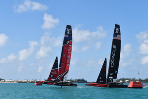 In this photo provided by the America's Cup Event Authority, Emirates Team New Zealand, left, competes along side Oracle Team USA in the 35th America's Cup sailing event. Photo / AP.
