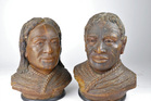 A pair of rare Maori busts carved from kauri gum have fetched $6250 at Auckland auction.