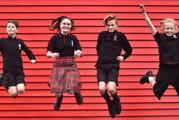 Dunedin North Intermediate pupils (from left) Caspar Rennie-Weston (11), Ella Clarke (12), James Johnson (13) and Taya Kain (11) wear four of the school's five uniform options. Photo / ODT