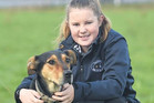 Up and coming Whanganui-Manawatu triallist Phoebe Smailes with her 4-year-old huntaway Sage.