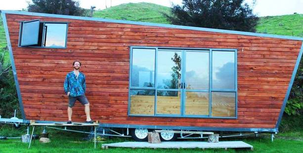 Leo Murray and his tiny house designed and still being built in Te Puna.