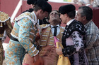 Spanish matador Ivan Fandino is assisted after being impaled by a Baltasar Iban bull during a bullfight at the Corrida des Fetes. Photo / AFP
