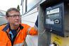Electrical contractor Allan Clark installs a smart meter for Trustpower. Photo/George Novak