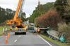 A 70-tonne crane was needed to lift first the trailer, then the truck back onto the highway. PHOTO / PETER DE GRAAF