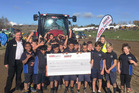Te Awamutu Primary students holding their winning $2000 cheque.
