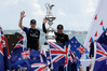 Peter Burling and Glenn Ashby wave as they stand next to the Americas Cup trophy after defeating Oracle Team USA. Photo / AP