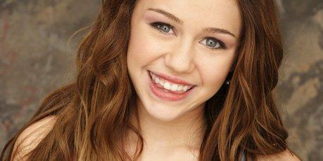 Miley Cyrus as Hannah Montana.