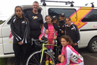 Kaitaia's champion cyclist Tyla-Mia Foster, with coach Phil Gibbs and fellow Far North Flash riders. Photo / 1 News Now