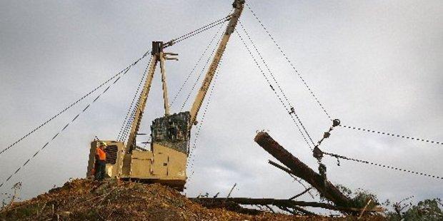 Loading Hickford Logging's Thunderbird 6255 Swinger hauler breaks the skyline at the top of Rangitatau West Rd in Maxwell.
