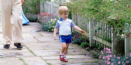 Prince Harry wearing the red shoes as a toddler growing up at Highgrove House. Photo / Getty