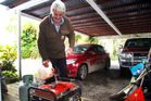 Taoroa resident Fraser Gordon pours petrol into his generator. Wanganui Chronicle photograph by Bevan Conley.