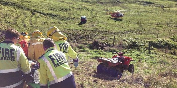 Emergency services attend a quad bike accident on a farm near Whangamata last year. An average 850 Kiwis are injured on farm quad bikes each year - and five die. Photo / File