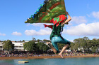 Laura Stevenson of Paihia jumps from Russell wharf in a costume inspired by the kakariki, a parakeet reintroduced to the Bay of Islands. Laura and husband Ryan won this year's crowd favourite title.