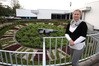 Ronda Chrystal in front of the Floral Clock, Marine Parade, Napier, one of three options for a new site for the war memorial and eternal flame. Photo / Duncan Brown