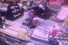 CCTV footage shows the would-be robber leaping onto the dairy counter in a single bound. PHOTO / SUPPLIED