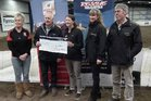 A cheque for $3000 was presented to the Taranaki Rescue Helicopter Trust after the dog trials. Pictured, left to right: Jan Wilson from Mighty Mix Dog Food, Ian Smith, president of the showring club, a Taranaki helicopter representative, Vanessa Sumpter from Tasman Toyota and Scott Morpeth from Wanganui Farm Supplies.