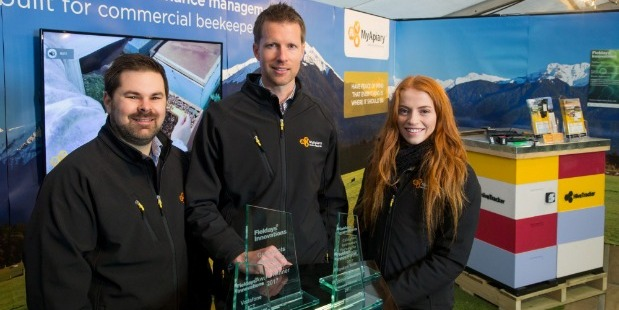 MyApiary co-founders Darren Bainbridge (left) and Carl Vink, and marketing intern Steph Fankhauser, with their award haul. Photo / Fieldays