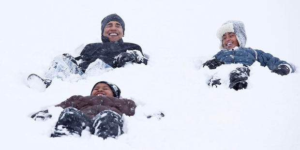 Loading US President Barack Obama in 2010 with his daughters in Washington. Photo / Pete Souza, White House