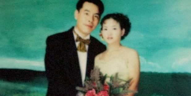 A wedding picture of Min Lin and Yun Li (Lilly) hangs on the wall inside the entrance to the Lin family home in Epping, Sydney. Source: News Limited