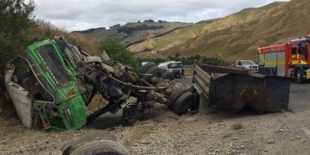 The man jumped from the truck before it hit a steep bank and rolled. Photo / Supplied