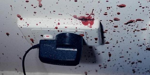 The mobile phone charger and bedroom wall was covered in blood. Picture: Supreme Court of NSW