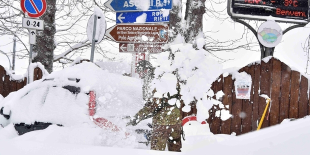 A soldier shovels snow in Amatrice, Italy. Photo / AP