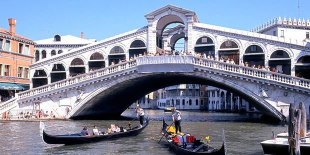 A Kiwi tourist landed in big trouble after a spectacular stunt off Venice's most famous bridge. Photo / 123RF