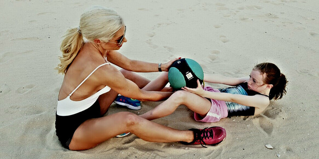 Simone Gately exercises with one of her daughters. Photo / CATERS