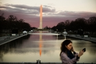 A woman takes a selfie in view of the Washington Monument as preparations continue for the inauguration. Photo / AP
