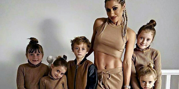 PIC FROM Caters News - (PICTURED: Simone Gately with her five children Summer, 10, Chester 8, Blossom, 6, India, 5 and Minnie 3) - The UKs fittest mum on the internet has shared her tips to beat the J