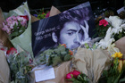 A Snappy Snaps store in Hampstead has become a shrine to George Michael, after the pop star died aged 53. Photo/AP