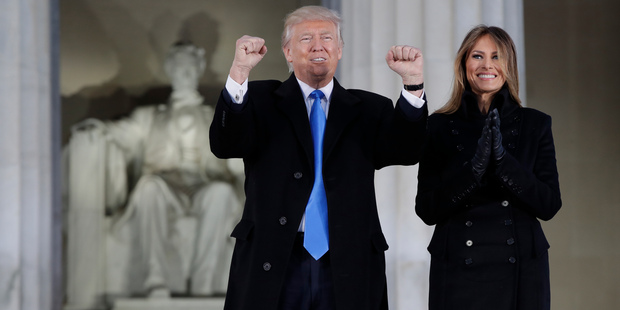 "President-elect Donald Trump and his wife Melania Trump arrive at a pre-Inaugural ""Make America Great Again! Welcome Celebration"" at the Lincoln Memorial in Washington, Thursday, Jan. 19, 20"