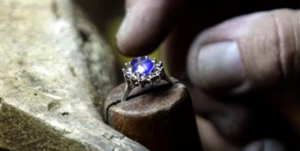 Frank Soto works on a replica of the Royal engagement ring at Natural Sapphire Co. in New York. Photo / AP