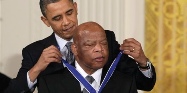 President Barack Obama presents a 2010 Presidential Medal of Freedom to John Lewis in February 2011. Photo / AP