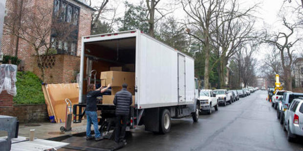 Movers, under the supervision of White House ushers, move President Barack Obama's family's belongings into their rented house in the Kalorama neighborhood of Washington. Photo / AP