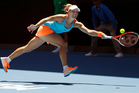 Germany's Angelique Kerber reaches for a forehand return to compatriot Carina Witthoeft during their second round match at the Australian Open. Photo / AP