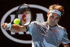 Switzerland's Roger Federer makes a backhand return to United States' Noah Rubin. Photo / AP