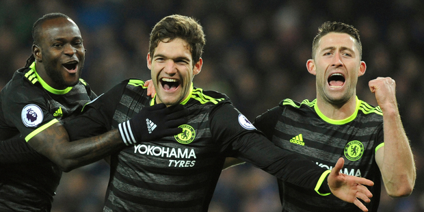 Chelsea's Marcos Alonso, centre, celebrates scoring his second goal against Leicester City. Photo / AP