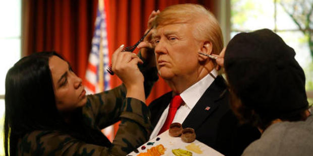 Madame Tussauds' designers apply the final touches to the wax figure of US President-elect Donald Trump. Photo / AP