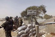Cameroon soldiers stand guard at a lookout post as they take part in operations against the Islamic extremists group Boko Haram in 2015. (Edwin Kindzeka Moki/AP)