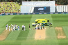 Mushfiqur Rahim is down after being hit by a Tim Southee bouncer. Photo / David Leggat.