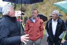 Labour leader Andrew Little and West Coast-Tasman MP Damien O'Connor talk to Bernie Monk at the Pike River picket this morning. Photo / Greymouth Star