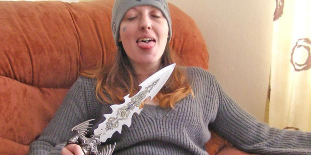 Serial killer Joanna Dennehy poses with a decorative dagger while on the run for murder. Photo / PA